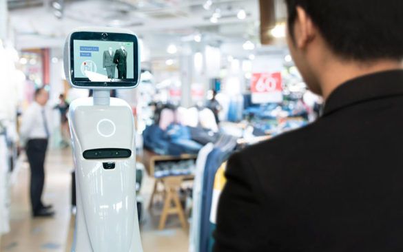 person standing in front of a shopping robot at a clothing store