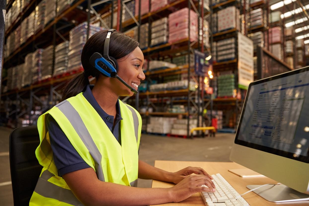 woman in warehouse with headset