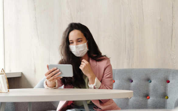 woman-wearing-a-mask-and-holding-her-phone